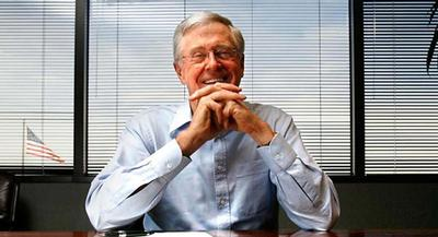 Charles Koch stumbled slightly on his way to the stage, as attendees squinted into a hot Southern California sun. | AP