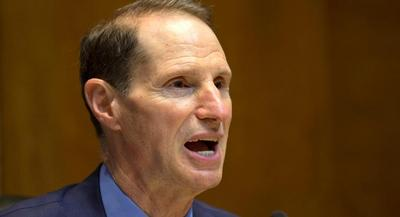 Sen. Ron Wyden stressed the importance of the fund to the 13 Senate Democrats who voted for the high-profile trade promotion authority bill Congress approved last month. | AP