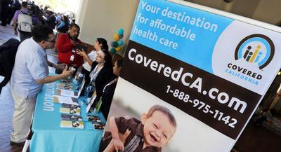 About 1.3 million people are enrolled in Covered California plans this year, including some 500,000 who signed up for exchange coverage for the first time. | AP