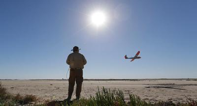 The ruling, for now, appears to make it legal for drones to fly at the low altitude as part of a business. | AP