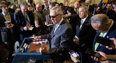 Senate Minority Leader Harry Reid speaks with reporters. | M. Scott Mahaskey