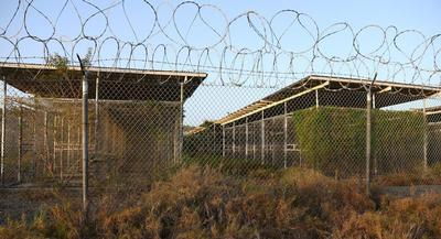 The Algerian detainee's departure leaves 154 prisoners at Guantanamo Bay prison, according to the Pentagon. | AP