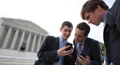 Ninety percent of government employees use mobile devices, according to a study last year by Mobile Work Exchange. | AP