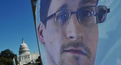 Edward Snowden's question came during an annual live broadcast with the president. | GETTY