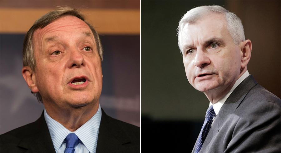 The fundraising hauls for Sens. Dick Durbin and Jack Reed, come as the two men take on new roles as defense leaders in the Senate. | GETTY