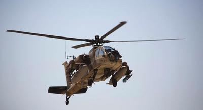 The Army could take all of the Guard's Apaches into the active force. | AP