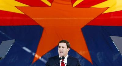 Gov. Doug Ducey has signed legislation that forbids Arizona from creating its own exchange, locking in the state's fate should the Supreme Court rule against the Obama administration in the King case. | AP