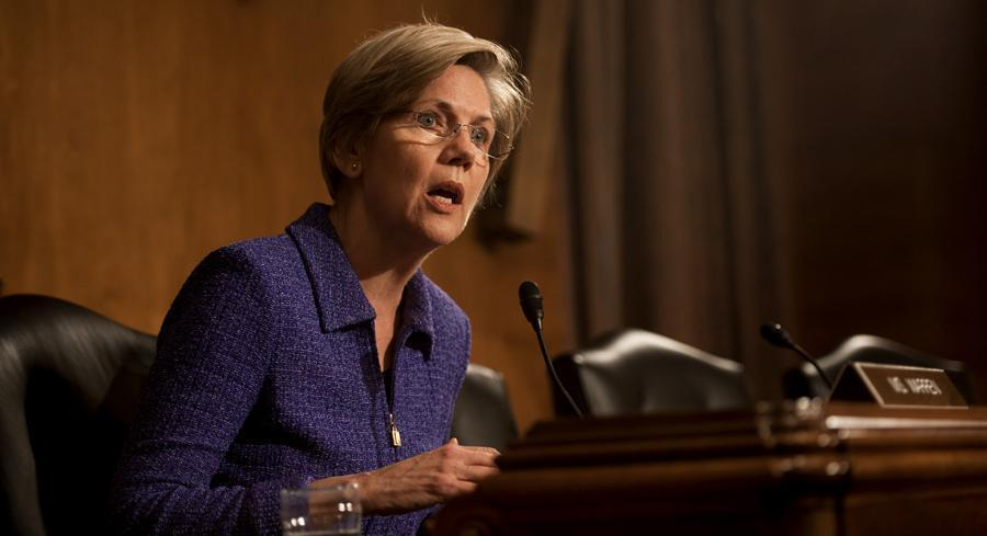 Elizabeth Warren's upcoming book delves into her views on the 2008 financial crisis and her role in building the CFPB. | JOHN SHINKLE / POLITICO