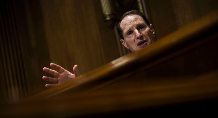 Ron Wyden complained hedge funds were taking advantage of long-standing provisions in the code allowing insurance companies to defer paying taxes. | GETTY