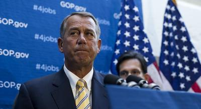 Boehner personally weighed in and huddled with a group of members on the floor. | JOHN SHINKLE/POLITICO