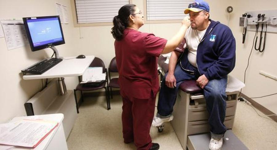 Survey after survey is showing that the number of uninsured people has been going down since the start of enrollment last fall. | AP