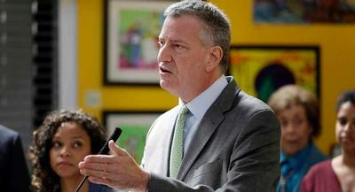 Bill de Blasio advisers say that more than 60 big names have signed on. | AP