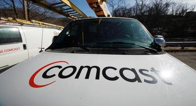 The transaction would grow Comcast's customer base by millions of subscribers.| AP