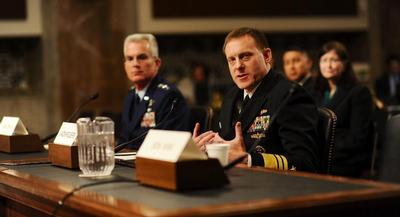 More than a dozen senators pressed Vice Adm. Mike Rogers for his views on government surveillance overreach. | JOHN SHINKLE/POLITICO