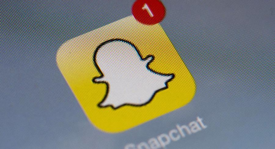 The rapidly growing social media application has been moving toward news with a feature called Snapchat Stories. | GETTY