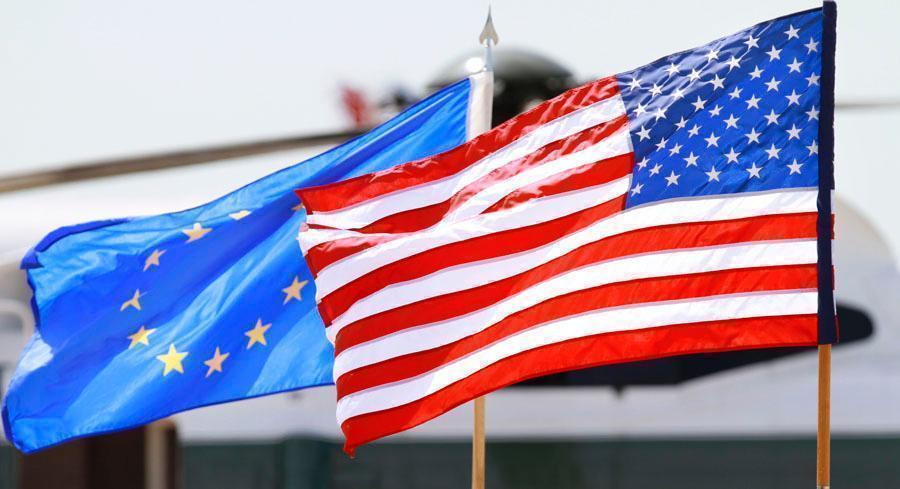 The U.S. and European Union flags are pictured. | AP