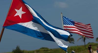 Only 32 percent of Cuban-Americans who came to the U.S. before 1980 say they disagree with the move. | AP