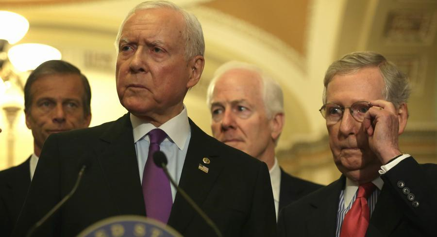 Mitch McConnell and Senate Finance Chairman Orrin Hatch chose to roll the dice and plow ahead with the vote. | GETTY