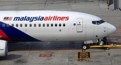 The plane disappeared early Saturday, shortly after leaving Kuala Lumpur on a red-eye flight to Beijing. | AP