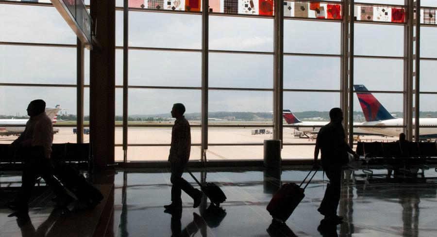A U.S. Travel Association survey said people would pay more for PFCs if they were used for airport projects to reduce flight delays, increase airline competition and improve the passenger experience. | MEREDITH MILLER/POLITICO