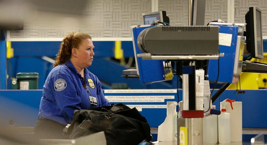 Even among those who think armed officers should guard airport checkpoints, there is still disagreement about whether that means arming TSA officers or relying on local law enforcement. | AP